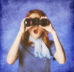 American redhead girl in suglasses with binocular