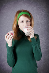 American redhead girl with milk and cake