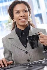 Smiling businesswoman working