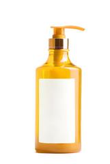 yellow plastic bottle of liquid soap