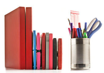 Stationery and books on white background