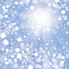 Vector of snowfall with sunlight rays on blue sky background
