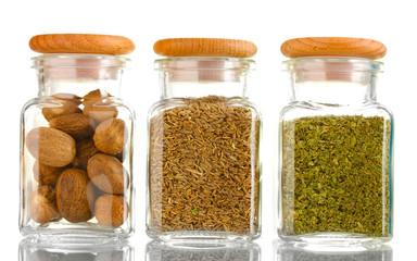Fotorolgordijn Kruiden powder spices in glass jars isolated on white