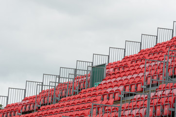 Empty grandstand with grey sky