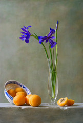 Still life with irises and apricots