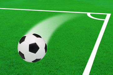 soccer ball on the green grass field