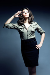 woman in military shirt and black skirt