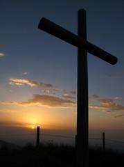Cross on the summit of a mountain, sunset