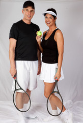 couple in tennis outfit, playing together
