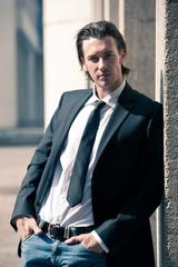 Confident young business man portrait outdoor.