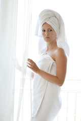 young woman in white towels
