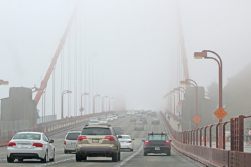 Traffic On The Foggy Golden Gate Bridge