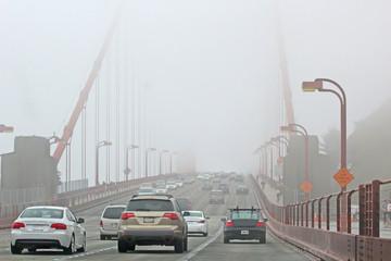 Traffic On The Foggy Golden Gate Bridge