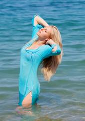Blonde girl sea