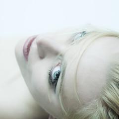 beautiful woman lying, looking into camera