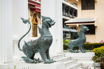 Two metal security dogs in buddhistic temple of Thailand, Bangko