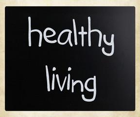 """Healthy living"" handwritten with white chalk on a blackboard"