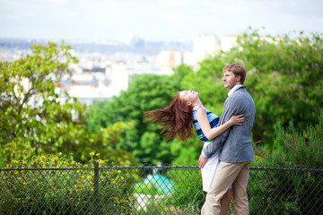 Sensual couple is hugging tenderly on Montmartre with nice view