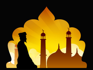 Silhouette of a Muslim man reading Namaz in Mosque or Masjid. EP