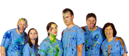 Family making faces after a paint fight