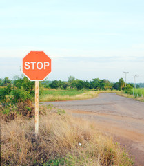 stop sign in a country road