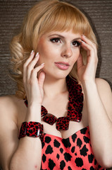 A large portrait of a beautiful blonde girl in a leopard dress