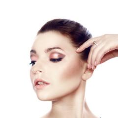 beautiful female model on white background. Close-up