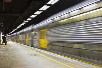 Train passing through Train Station