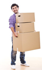 Young and handsome guy carrying boxes