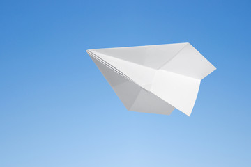 Wall Mural - Paper airplane against the blue sky