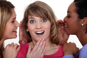 Three girls gossiping