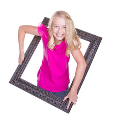 A girl climbing through a picture frame