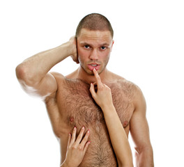 Woman's hands touching man's lips. Isolated on white.