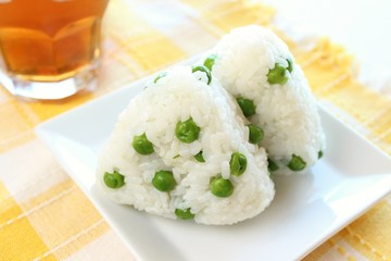 Japanese cuisine rice ball Onigiri with green-peas