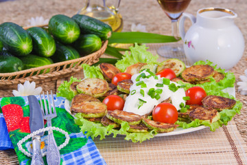 baked vegetable marrows with tomatoes and fresh cucumbers