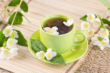 green tea and sprigs of jasmin