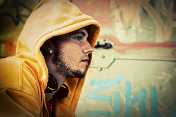 Young man portrait on graffiti grunge wall