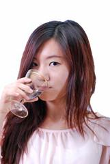 Asian girl drinking