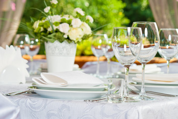 Beautifully served table in a summer pavilion