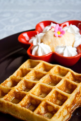 waffle and vanilla ice cream with whipped cream