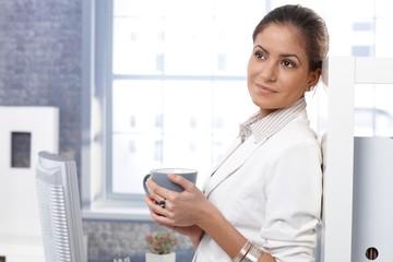 Businesswoman drinking tea
