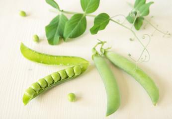 Three pods of green peas