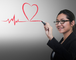 Woman drawing heart beat line, medical concept