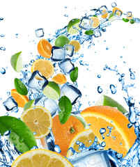 Fresh citruses in water splash with ice cubes