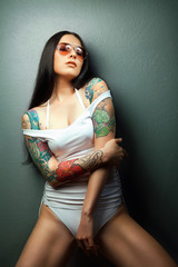 sexy glamorous girl with tattoos.