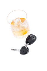 Car key and a whiskey on the rocks