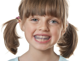 little girl with plastic braces isolated on white