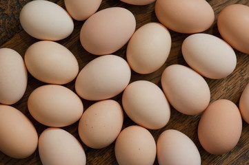 Brown eggs at wooden table background. Shallow depth of field