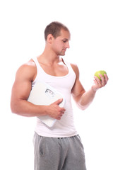 Muscular guy with scales and green apple