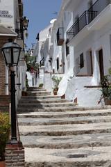 Small street in Andalusian mountain village Frigiliana, Spain